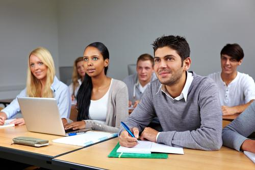 college-students-taking-notes-classroom